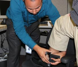Deputy Probation Officer attaches electronic monitoring anklet.